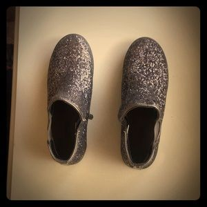 A Michel kors glittery shoe that is a size 7.5-8